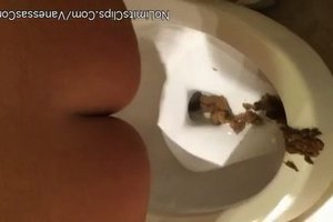 The girl quickly pooping in the toilet