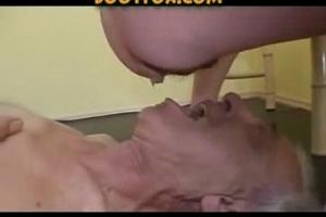 Two women shit in the mouth of an old man