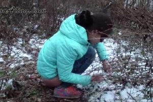 Alina pooping in the winter forest