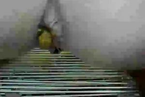 Girl pooping on the deck chair outdoor