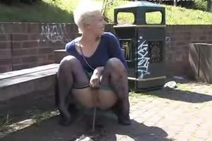 Mad woman piss on the alley near the pond