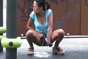 Woman pissing in the street