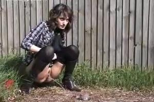 Bianca pee behind a fence
