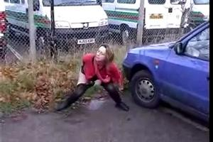 Woman pissing in the parking lot