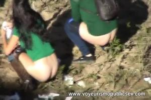 Many peeing girls outdoor 3